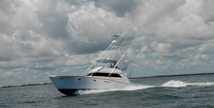 the natural palm beach charter fishing boat cruising